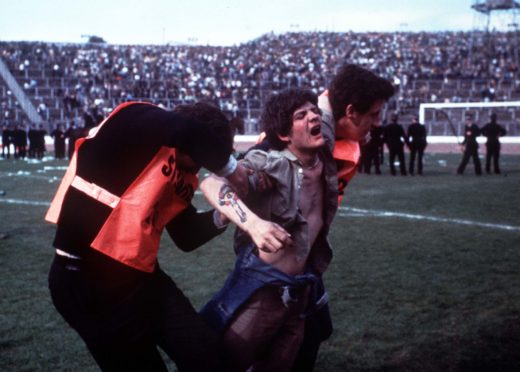 Stewards remove a fan during the Scottish Cup Final at Hampden in May 1980