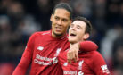 Liverpool's Virgil Van Dijk and Andy Robertson
