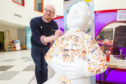 Cartoonist Neil Slorance is one of the artists that has designed an Oor Wullie for the Bucket Trail. Neil has been drawing patients and workers at Glasgow's Children's Hospital onto the statue