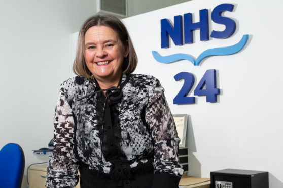 Margaret McGee, pharmacist, who works as a call handler at NHS 24 .