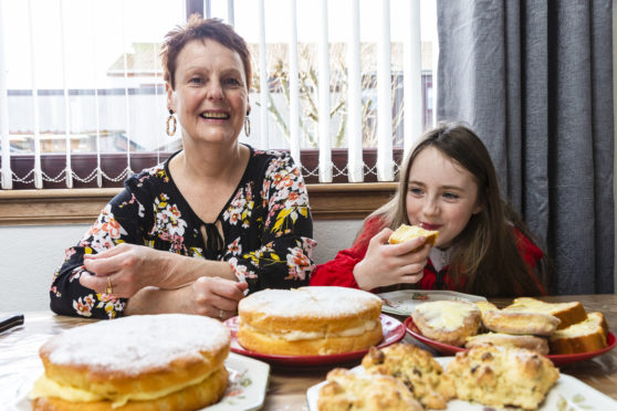 Anne Mclean, who makes scones and cakes for the ice cream shop she works in got a new oven which was faulty. When the repairman came to look at it her told her it was her cooking that had caused the problem. Anne pictured with her granddaughter Heidi McLean, 6, enjoying some of the cakes she bakes.