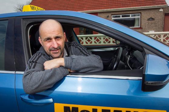 Nigel Young in his Skoda