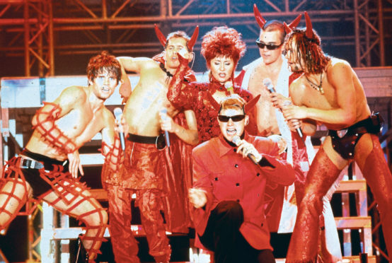 Take That with Lulu in 1993 performing Relight My Fire. She joined the lads on their Odyssey tour last week