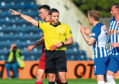 Referee Steven McLean brandishes his third red card to Kilmarnock last weekend