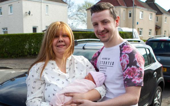 Chris and Carol Sichi, with their newborn baby girl, Kori