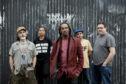 Benjamin Zephaniah (centre) with band the Revolutionary Minds