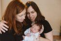 Same-sex couple Sara and Hanna Moy with their baby, Struan.