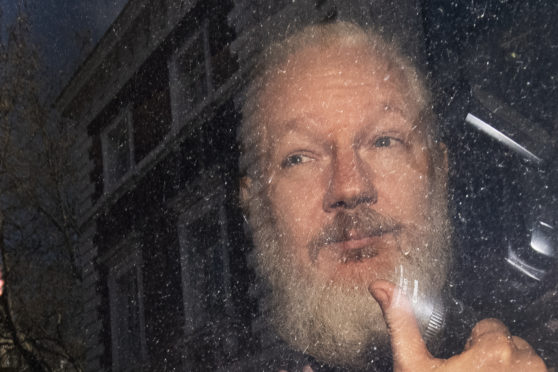 Julian Assange. More than 70 Parliamentarians have signed a letter urging the Government to ensure the WikiLeaks founder faces Swedish authorities if they request his extradition.