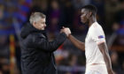 Manchester United coach Ole Gunnar Solskjaer with Paul Pogba