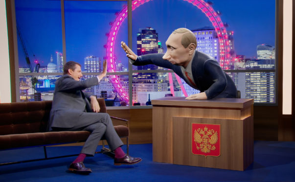 Alistair Campbell speaking to a 3D digital cartoon of Vladimir Putin, who will be the new chat show host