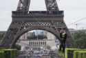A woman zipslides from the Eiffel Tower