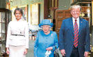 Queen Elizabeth II stands with US President Donald Trump and his wife, Melania, in the Grand Corridor during their visit to Windsor Castle in Berkshire last year