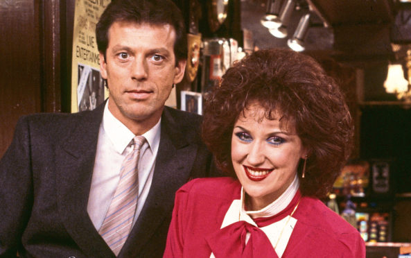 Actors Leslie Grantham and Anita Dobson pictured in the Queen Vic