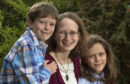 Fighting on... Dr Kay Kelly with sons Ronan, 9, and Lewin, 12 at home in Inverness