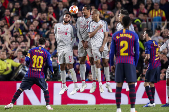 Lionel Messi's stunning free-kick goes over the Liverpool wall en route to the net to put Barca three