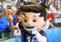 Fans take photographs with Euro 2016 mascot Super Victor prior to the championships final in Paris