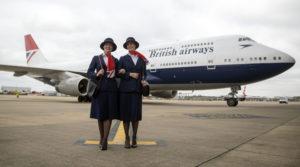 Ambassadors Elysa Marsden (left) Olivia Welch in front of a Boeing 747 in  British Airways' centenary fleet
