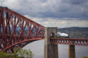 The Flying Scotsman crosses the Forth Bridge on its way from Edinburgh to Inverness