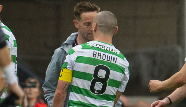 Celtic's Scott Brown (right) clashes with Hearts' Steven MacLean after the full time whistle