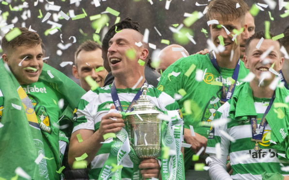 Celtic's Scott Brown celebrates winning the William Hill Scottish Cup