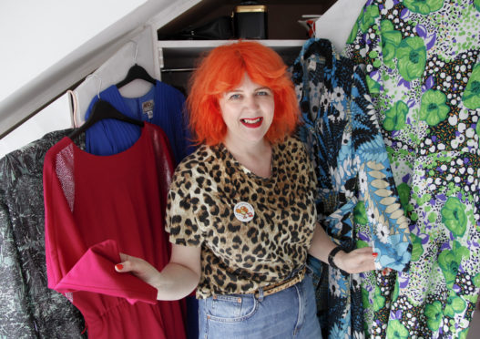 Self-confessed lifelong hoarder Merle Brown's wardrobe is bulging with outfits she simply can't bear to throw away