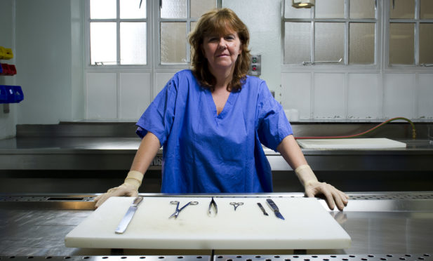 Marjorie Turner in the mortuary suite where she performs post-mortems on up to 20 suspected overdose cases  a week