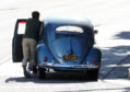 Ewan McGregor pushes his broken-down 1954 Volkswagen Beetle to the kerb in LA earlier this year