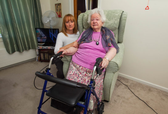 Mary Davison with her daughter Heather have been complaining about her electric chair for months, Mary says its umcomfortable and there was a bang from it.