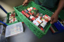 Emergency food parcels handed out to children in Scotland rose by more than a fifth last summer, new figures indicate.