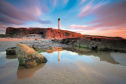The lighthouse at Lossiemouth on the Moray Firth at sunset