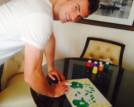 Andy Murray signs his handprints