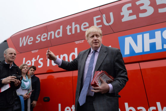 PM hopeful Boris Johnson in front of NHS bus