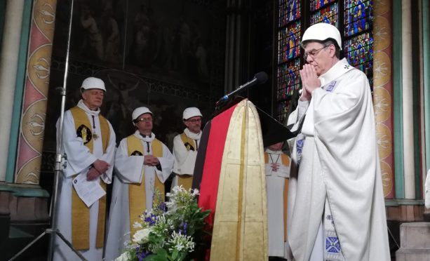 Pirests in hard hats host first mass in Notre Dame since April inferno