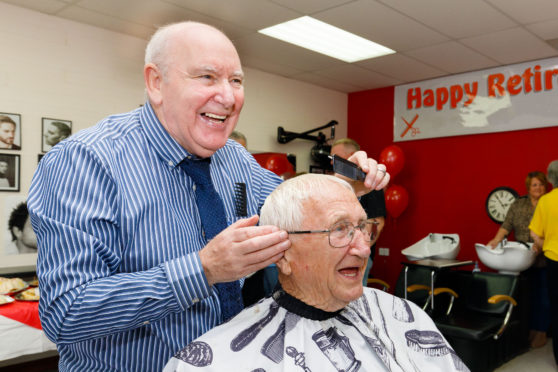 Retiring barber Milson Orr gives last haircut to same customer Frank Franklyn, 95, who he gave his first haircut to 57 years ago.