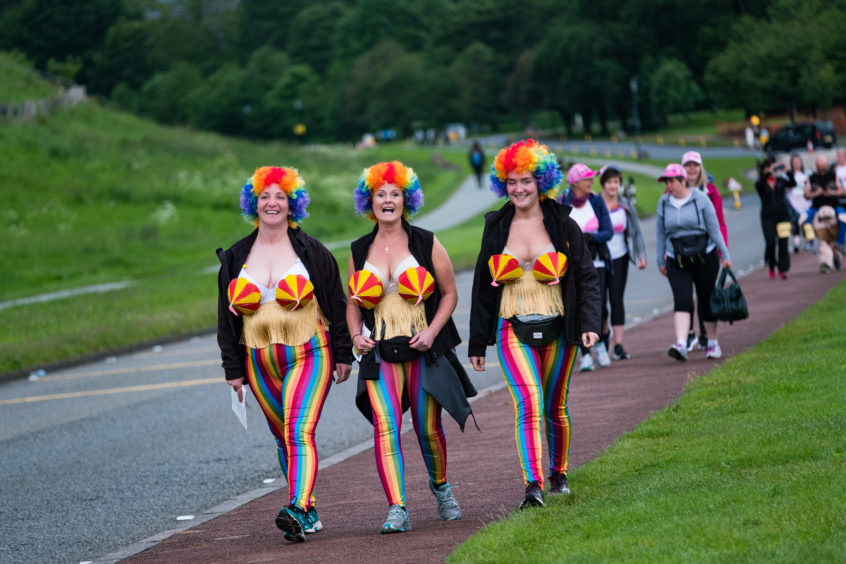 Walkers arriving for the start of the MoonWalk at Holyrood Park