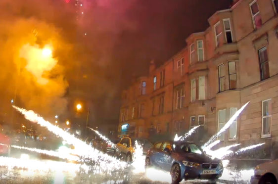 A fireworks goes off under a car in Kenmuir Street, Pollokshields, Glasgow last year. Numerous incidents                           have been recorded by the public