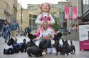 16-year-old Jessica Thain poses with the Scottie dogs and Oor Wullie