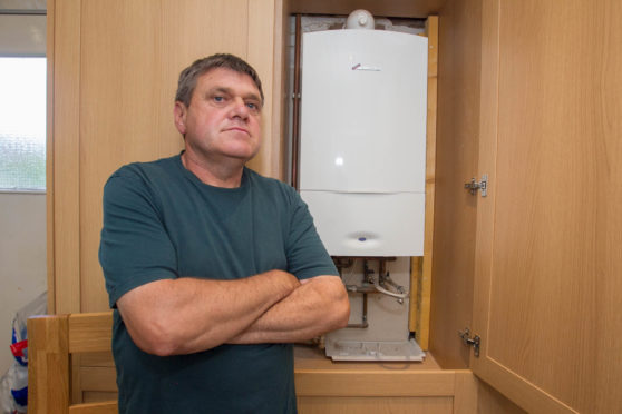 Donald Marquis bought a green boiler on credit and it is costing him a fortune.