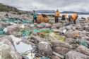 Kayakers clean beaches around the Summer Isles earlier this year.