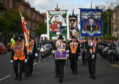 Members of the Orange Order take part in the Glasgow parade