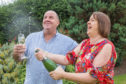 Alan and Claire Gray celebrating £1 million in the EuroMillions.