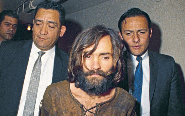 Charles Manson is taken to court in Los Angeles after 1969 murders