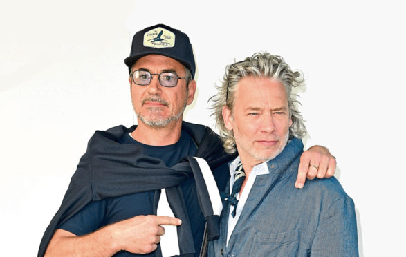 Dexter Fletcher (right) is set to direct Robert Downey Jr. as Sherlock Holmes