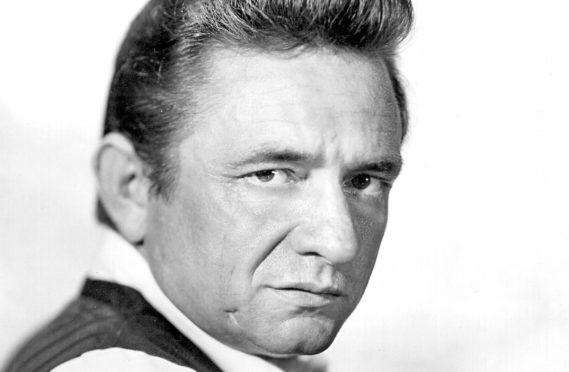 Johnny Cash poses for a portrait circa 1969