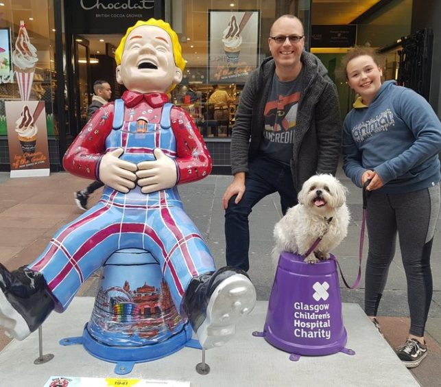 Gary Duncan, 42, Amy Duncan, 11 and Pippin the dog, 7, from Gartcosh