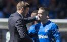 Rangers manager Steven Gerrard embraces Ryan Kent last season after beating Celtic