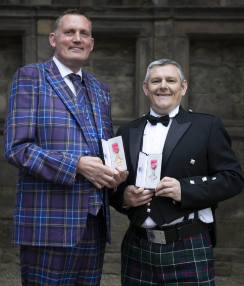 Rugby legend Doddie Weir and Tourette's campaigner John Davidson after  being made OBE and MBE respectively at Palace of Holyroodhouse in Edinburgh