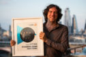 Frontman of Snow Patrol Gary Lightbody receives the award for Most Played song of the 21st century