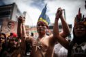 Climate activist groups protest in different Colombian cities to call on the Brazilian government to increase efforts to control and prevent wildfires at the Amazon rainforest in Bogota, Colombia on August 23, 2019.