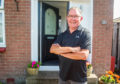 Brian Baxter at home after new door is fitted